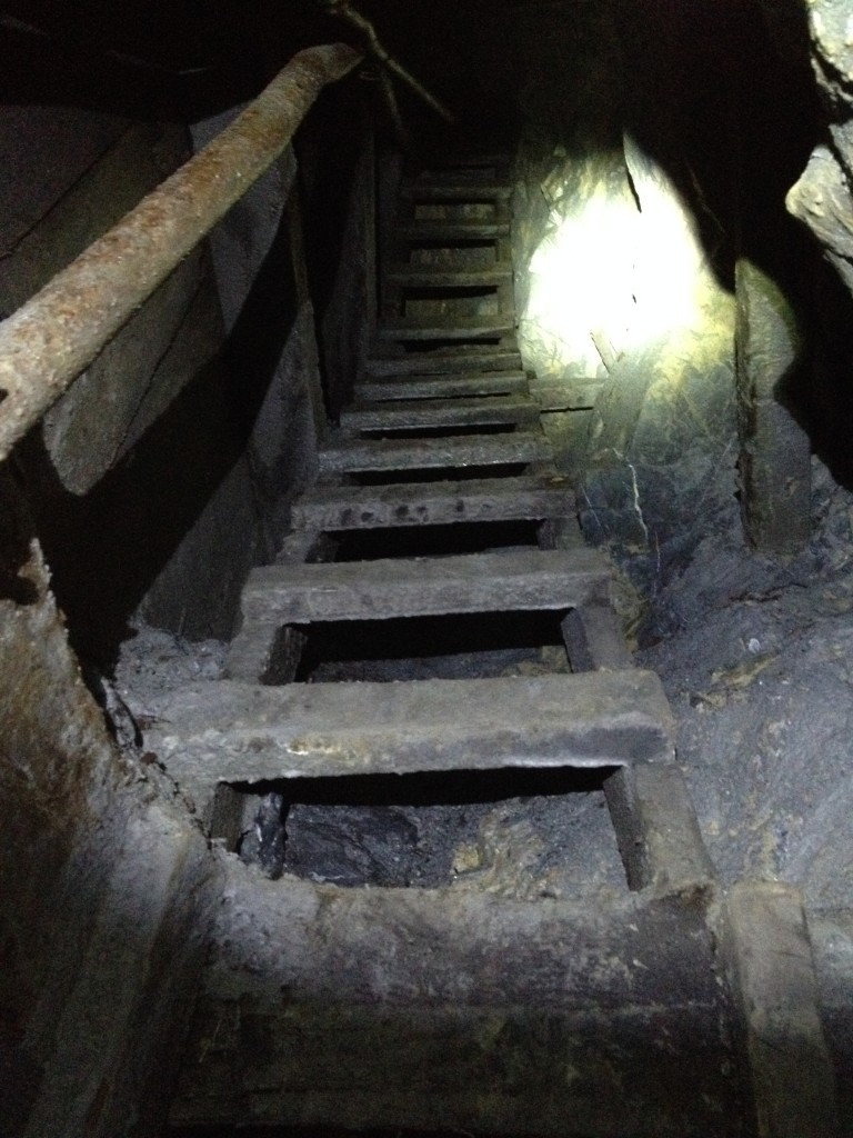 Wooden stairs leading to the top of an ore chute. The stairs are about 30+ feet high