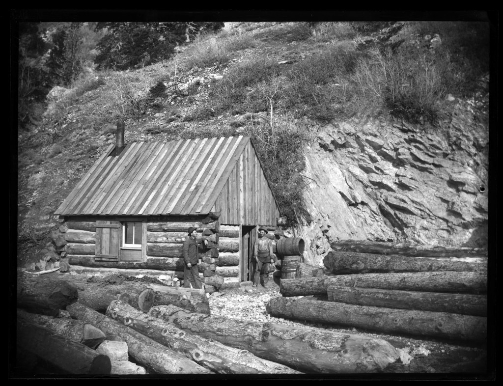 Miners_at_a_log_cabin_with_timbers_at_the_Baker_silver_mine