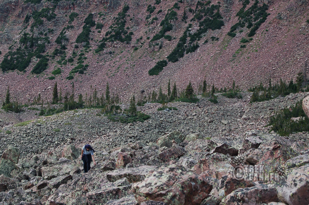 One of our hikers putting the rocks to scale.