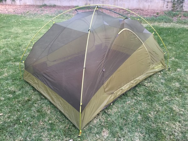 Throw the rain fly over the tent and use the buckles to clip into the tent. 69f259bdb7ac